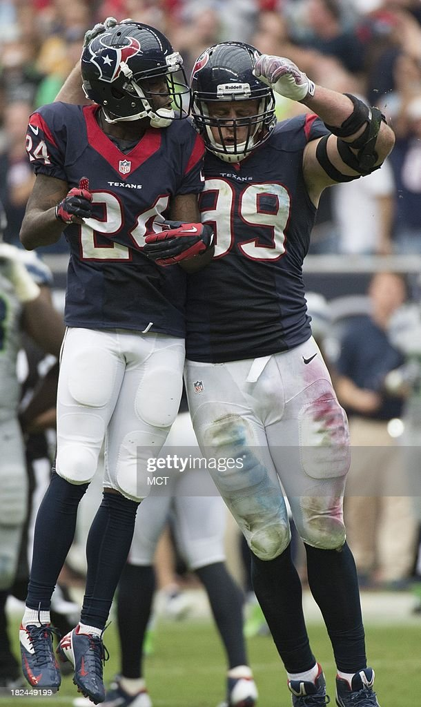 Johnathan Joseph (24) and J.J. Watt (99) of the Houston Texans celebrate a sack against the Seattle Seahawks in the second half of a 23-20 Seattle overtime victory on Sunday, September 29, 2013, in Houston, Texas.
