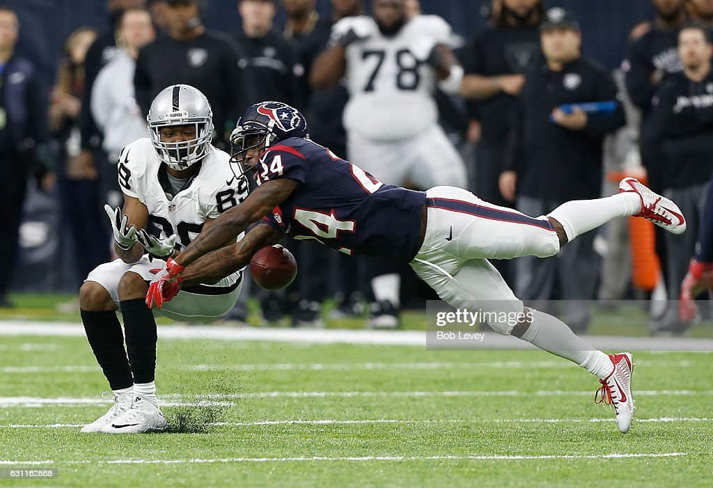 Johnathan Joseph #24 of the Houston Texans breaks up a pass to Amari Cooper #89 of the Oakland Raiders during the first half of their AFC Wild Card game at NRG Stadium on January 7, 2017 in Houston, Texas.