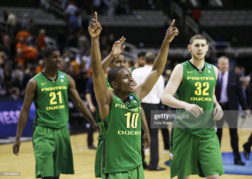 Johnathan Loyd #10, Damyean Dotson #21 and Ben Carter #32 of the Oregon Ducks celebrate their 68 to 55 win over the Oklahoma State Cowboys during the second round of the 2013 NCAA Men's Basketball Tournament at HP Pavilion on March 21, 2013 in San Jose, California.