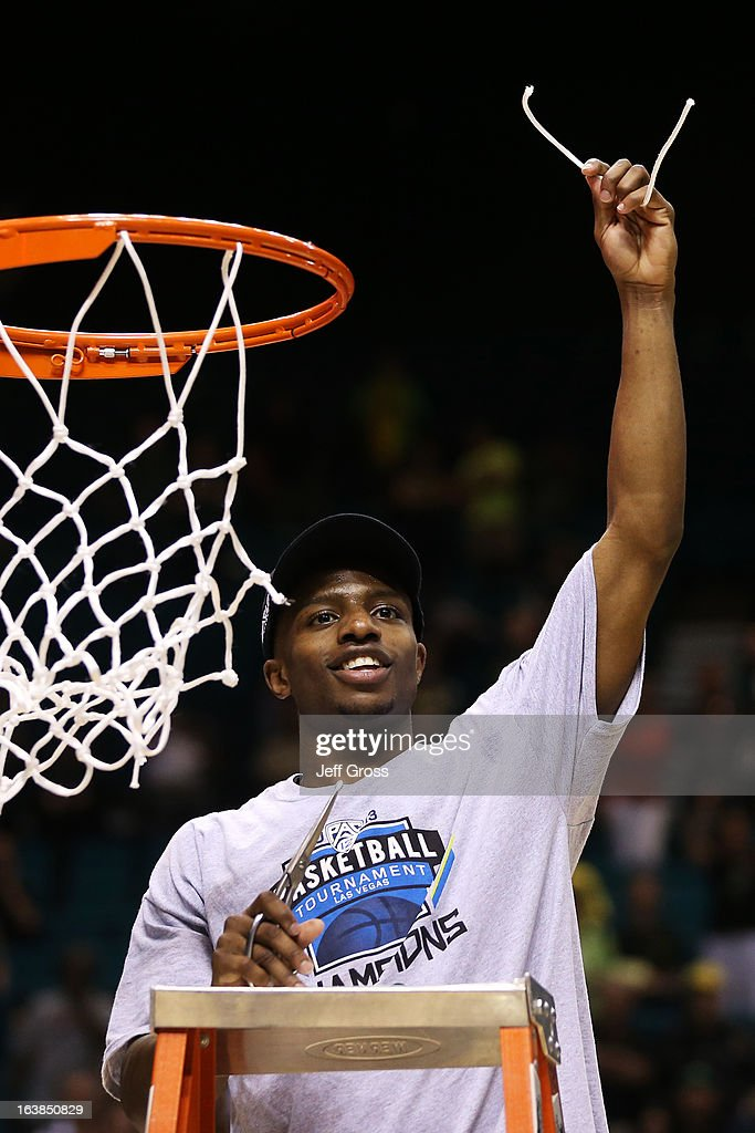 Johnathan Loyd #10 of the Oregon Ducks celebrates by cutting down the net after they defeated the UCLA Bruins 78 to 69 in the Pac-12 Championship game at MGM Grand Garden Arena on March 16, 2013 in Las Vegas, Nevada.