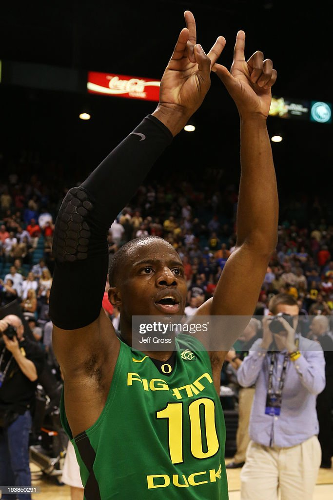 Johnathan Loyd #10 of the Oregon Ducks celebrates their 78 to 69 win over the UCLA Bruins during the Pac-12 Championship game at MGM Grand Garden Arena on March 16, 2013 in Las Vegas, Nevada.