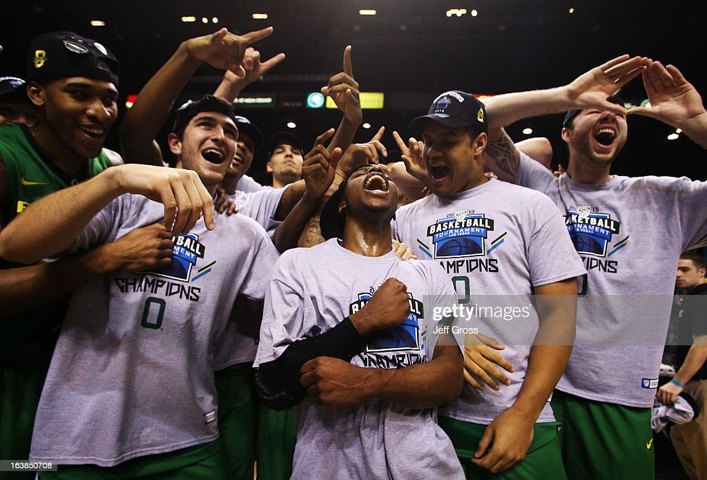 Johnathan Loyd #10 (C) of the Oregon Ducks celebrates with teammates after they defeated the UCLA Bruins 78 to 69 in the Pac-12 Championship game at MGM Grand Garden Arena on March 16, 2013 in Las Vegas, Nevada.