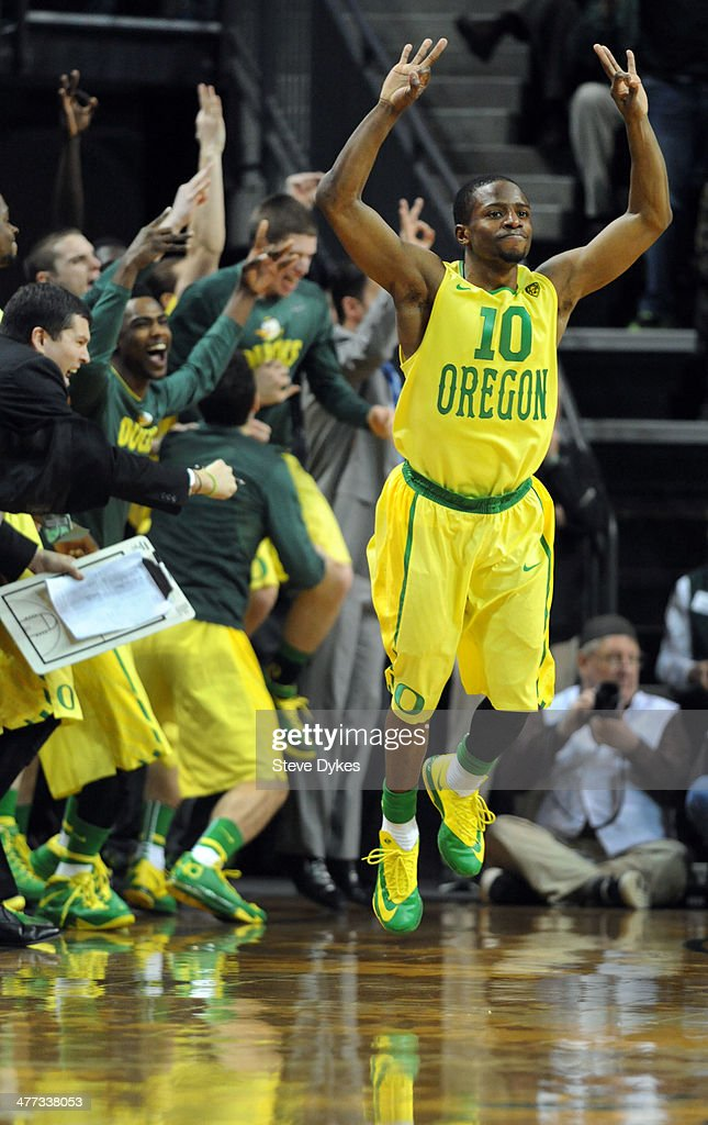 <a gi-track='captionPersonalityLinkClicked' href=/galleries/search?phrase=Johnathan+Loyd&family=editorial&specificpeople=7363260 ng-click='$event.stopPropagation()'>Johnathan Loyd</a> #10 of the Oregon Ducks reacts after hitting a key three point shot during the second half of the game against the Arizona Wildcats at Matthew Knight Arena on March 8, 2014 in Eugene, Oregon. Oregon won the game 64-57.