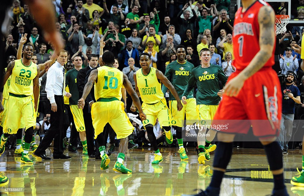 <a gi-track='captionPersonalityLinkClicked' href=/galleries/search?phrase=Johnathan+Loyd&family=editorial&specificpeople=7363260 ng-click='$event.stopPropagation()'>Johnathan Loyd</a> #10 of the Oregon Ducks runs to celebrate with Dominic Artis #1 of the Oregon Ducks during the second half of the game against the Arizona Wildcats at Matthew Knight Arena on March 8, 2014 in Eugene, Oregon. Oregon won the game 64-57.