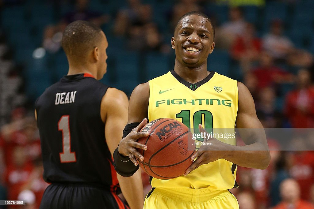 Johnathan Loyd #10 of the Oregon Ducks smiles in the second half while taking on the Utah Utes during the semifinals of the Pac-12 tournament at the MGM Grand Garden Arena on March 14, 2013 in Las Vegas, Nevada.