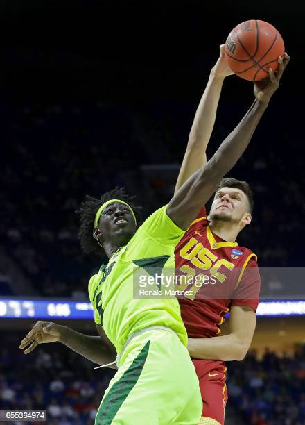 Johnathan Motley of the Baylor Bears battles for the rebound with Nick Rakocevic of the USC Trojans during the second round of the 2017 NCAA Men's...