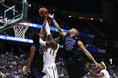 Johnathan Motley of the Baylor Bears goes up for a shot against Markus Crider and Curtis Washington of the Georgia State Panthers in the second half...
