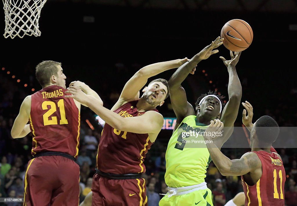 Johnathan Motley #5 of the Baylor Bears rebounds the ball against Matt Thomas #21 of the Iowa State Cyclones, <a gi-track='captionPersonalityLinkClicked' href=/galleries/search?phrase=Georges+Niang&family=editorial&specificpeople=10061173 ng-click='$event.stopPropagation()'>Georges Niang</a> #31 of the Iowa State Cyclones, and <a gi-track='captionPersonalityLinkClicked' href=/galleries/search?phrase=Monte+Morris&family=editorial&specificpeople=9612438 ng-click='$event.stopPropagation()'>Monte Morris</a> #11 of the Iowa State Cyclones at Ferrell Center on February 16, 2016 in Waco, Texas.