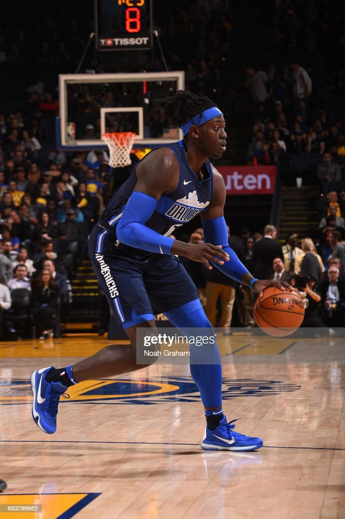 Johnathan Motley #6 of the Dallas Mavericks handles the ball against the Golden State Warriors on December 14, 2017 at ORACLE Arena in Oakland, California.