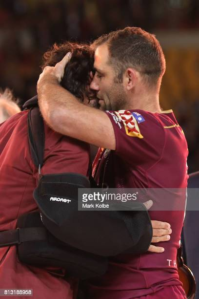 Johnathan Thurston and Cameron Smith of the Maroons embrace on the podium after winning game three of the State Of Origin series between the...
