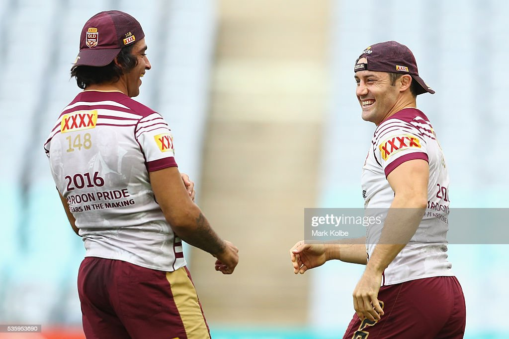 <a gi-track='captionPersonalityLinkClicked' href=/galleries/search?phrase=Johnathan+Thurston&family=editorial&specificpeople=233427 ng-click='$event.stopPropagation()'>Johnathan Thurston</a> and <a gi-track='captionPersonalityLinkClicked' href=/galleries/search?phrase=Cooper+Cronk&family=editorial&specificpeople=234620 ng-click='$event.stopPropagation()'>Cooper Cronk</a> share a laugh during a Queensland Maroons State Of Origin captain's run at ANZ Stadium on May 31, 2016 in Sydney, Australia.