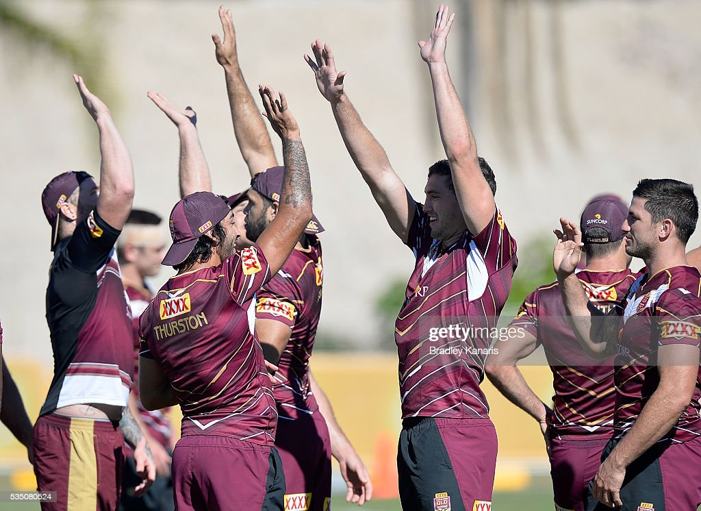<a gi-track='captionPersonalityLinkClicked' href=/galleries/search?phrase=Johnathan+Thurston&family=editorial&specificpeople=233427 ng-click='$event.stopPropagation()'>Johnathan Thurston</a> and Corey Oates high five during a Queensland Maroons State of Origin training session on May 29, 2016 in Gold Coast, Australia.
