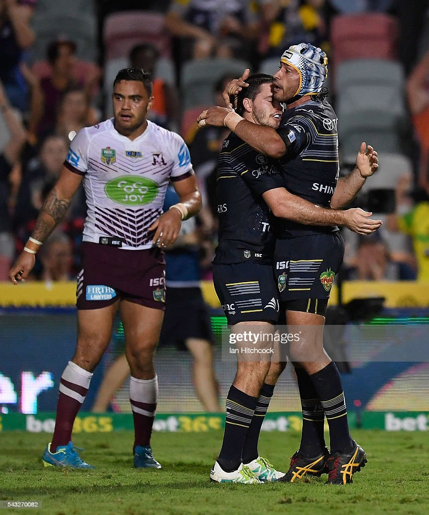 <a gi-track='captionPersonalityLinkClicked' href=/galleries/search?phrase=Johnathan+Thurston&family=editorial&specificpeople=233427 ng-click='$event.stopPropagation()'>Johnathan Thurston</a> and Lachlan Coote of the Cowboys embrace after a try which was scored by Antonio Winterstein of the Cowboys during the round 16 NRL match between the North Queensland Cowboys and the Manly Sea Eagles at 1300SMILES Stadium on June 27, 2016 in Townsville, Australia.