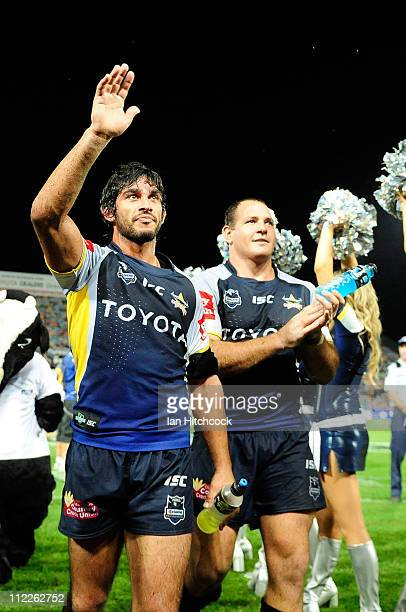 Johnathan Thurston and Matt Scott wave to the crowd after winning the round six NRL match between the North Queensland Cowboys and the Canberra...