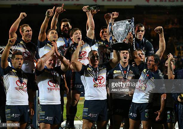 Johnathan Thurston and Matthew Scott of North Queensland Cowboys lift the World Club Series trophy after victory over Leeds Rhinos in the World Club...