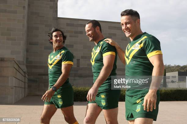 Johnathan Thurston Boyd Cordner and Cooper Cronk share a laugh as they walk to the team photo during an Australian Kangaroos media opportunity at the...