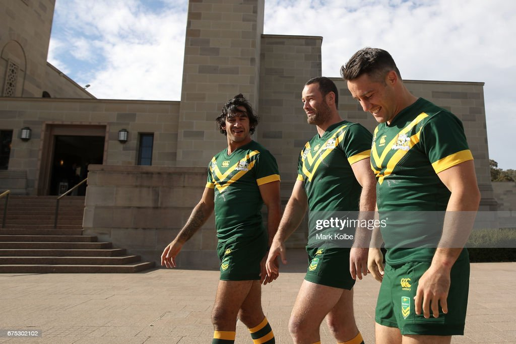 Johnathan Thurston, Boyd Cordner and Cooper Cronk share a laugh as they walk to the team photo during an Australian Kangaroos media opportunity at the Australian War Memorial on May 1, 2017 in Canberra, Australia.