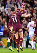 Johnathan Thurston Corey Parker and Matt Gillett of the Maroons celebrate victory after game two of the State Of Origin series between the Queensland...