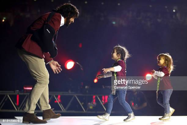 Johnathan Thurston is greeted by his daughters Frankie and Charlie before game three of the State Of Origin series between the Queensland Maroons and...