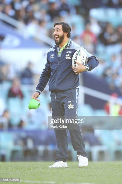 Johnathan Thurston laughs as he watches on during the warmup before the NRL Elimination Final match between the Cronulla Sharks and the North...