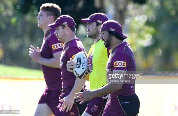 Johnathan Thurston Matt Gillett Michael Morgan and Dylan Napa run through a training drill during a Queensland Maroons training session at Sanctuary...