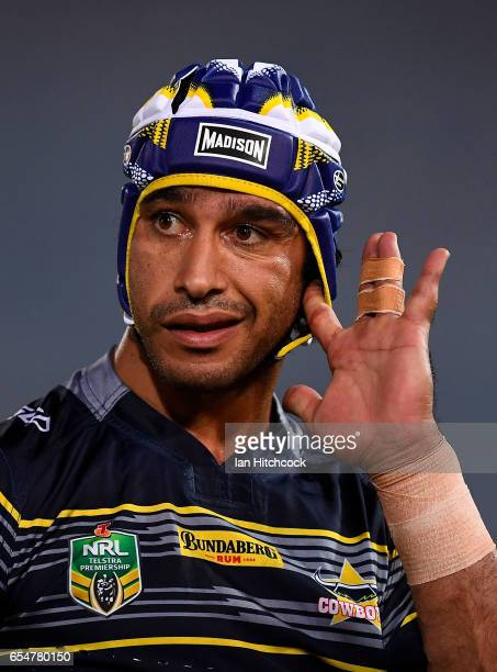 Johnathan Thurston of the Cowboys adjusts his head gear before the start the round three NRL match between the North Queensland Cowboys and the Manly...