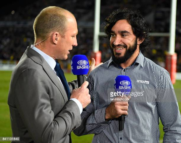 Johnathan Thurston of the Cowboys and former NRL player Darren Lockyer do a piece to camera before the start of the start of the round 26 NRL match...