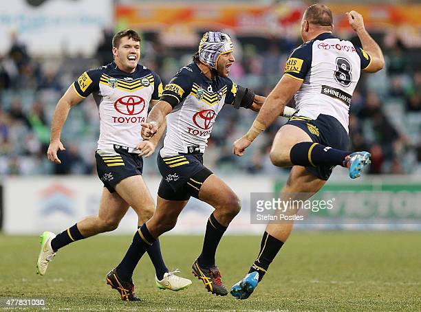 Johnathan Thurston of the Cowboys celebrates after kicking a field goal to win the round 15 NRL match between the Canberra Raiders and the North...