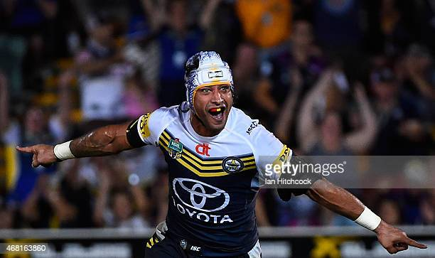 Johnathan Thurston of the Cowboys celebrates after kicking the winning field goal during the round four NRL match between the North Queensland...