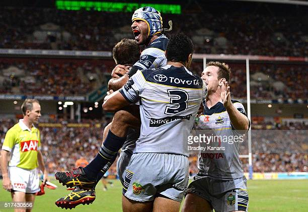 Johnathan Thurston of the Cowboys celebrates but the try is disallowed during the round four NRL match between the Brisbane Broncos and the North...