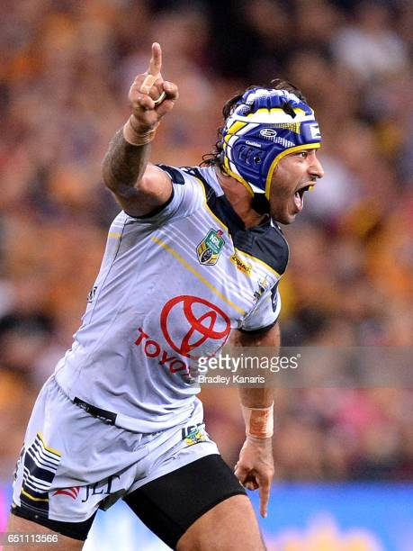 Johnathan Thurston of the Cowboys celebrates victory after kicking the winning field goal in golden point exra time during the round two NRL match...