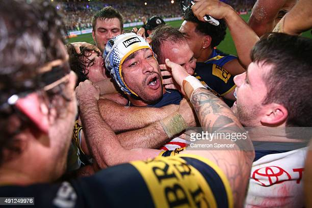 Johnathan Thurston of the Cowboys celebrates with team mates after winning the 2015 NRL Grand Final match between the Brisbane Broncos and the North...