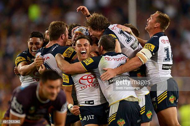 Johnathan Thurston of the Cowboys celebrates with team mates after kicking the winning field goal during the 2015 NRL Grand Final match between the...