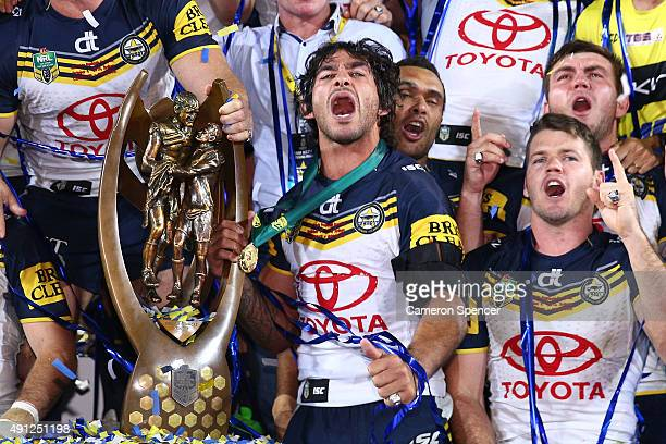 Johnathan Thurston of the Cowboys celebrates with the premiership trophy after winning the 2015 NRL Grand Final match between the Brisbane Broncos...