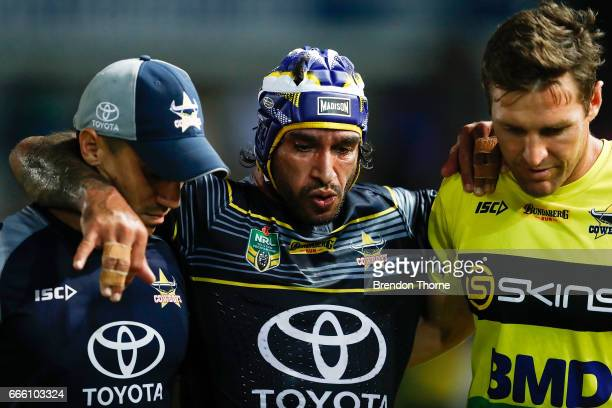 Johnathan Thurston of the Cowboys is helped from the field during the round six NRL match between the North Queensland Cowboys and the Wests Tigers...