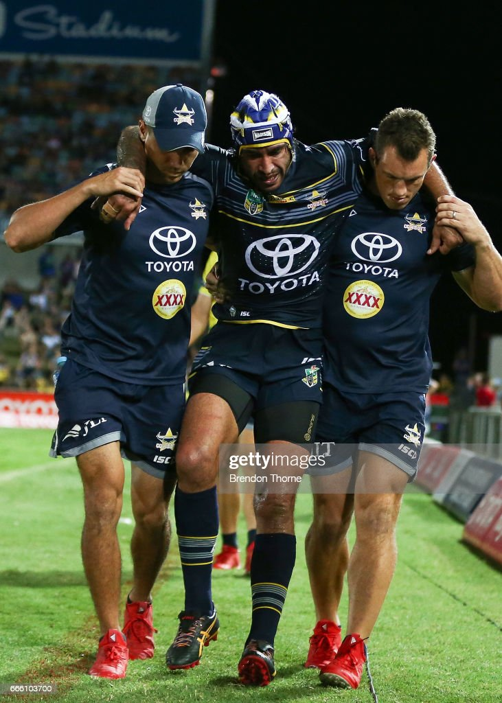 Johnathan Thurston of the Cowboys is helped from the field during the round six NRL match between the North Queensland Cowboys and the Wests Tigers at 1300SMILES Stadium on April 8, 2017 in Townsville, Australia.