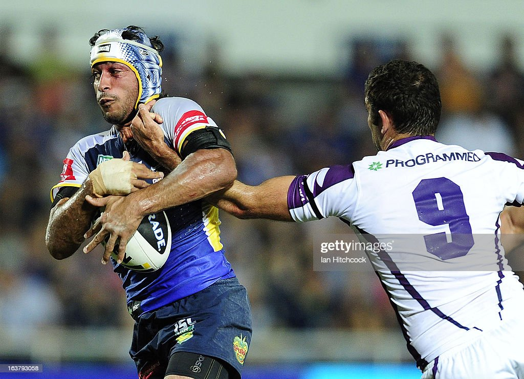 <a gi-track='captionPersonalityLinkClicked' href=/galleries/search?phrase=Johnathan+Thurston&family=editorial&specificpeople=233427 ng-click='$event.stopPropagation()'>Johnathan Thurston</a> of the Cowboys is tackled by <a gi-track='captionPersonalityLinkClicked' href=/galleries/search?phrase=Cameron+Smith+-+Rugbyer&family=editorial&specificpeople=453295 ng-click='$event.stopPropagation()'>Cameron Smith</a> of the Strom during the round two NRL match between the North Queensland Cowboys and the Melbourne Storm at 1300SMILES Stadium on March 16, 2013 in Townsville, Australia.