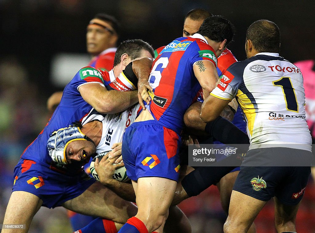 <a gi-track='captionPersonalityLinkClicked' href=/galleries/search?phrase=Johnathan+Thurston&family=editorial&specificpeople=233427 ng-click='$event.stopPropagation()'>Johnathan Thurston</a> of the Cowboys is tackled by the Knights defence during the round three NRL match between the Newcastle Knights and the North Queensland Cowboys at Hunter Stadium on March 25, 2013 in Newcastle, Australia.
