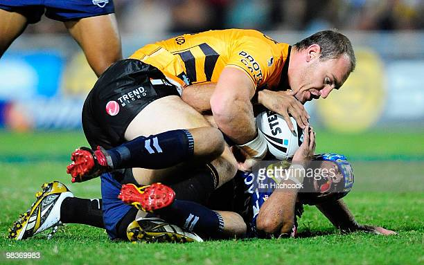 Johnathan Thurston of the Cowboys lies on the ground after being accidently injured by Gareth Ellis of the Tigers during the round five NRL match...
