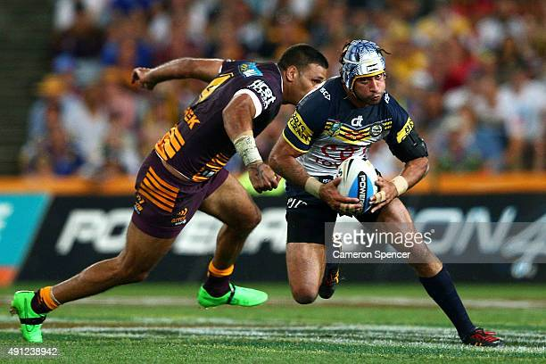 Johnathan Thurston of the Cowboys makes a break during the 2015 NRL Grand Final match between the Brisbane Broncos and the North Queensland Cowboys...