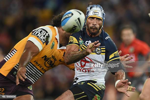 Johnathan Thurston of the Cowboys passes the ball during the NRL Qualifying Final match between the Brisbane Broncos and the North Queensland Cowboys...