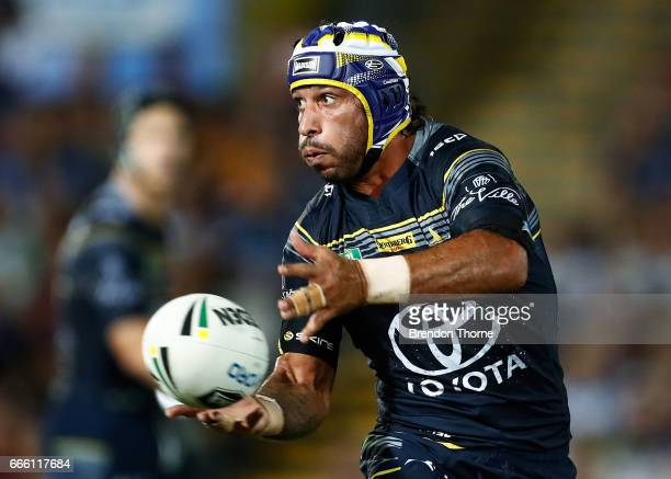Johnathan Thurston of the Cowboys passes the ball to a team mate during the round six NRL match between the North Queensland Cowboys and the Wests...
