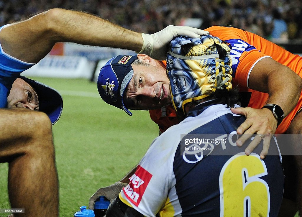<a gi-track='captionPersonalityLinkClicked' href=/galleries/search?phrase=Johnathan+Thurston&family=editorial&specificpeople=233427 ng-click='$event.stopPropagation()'>Johnathan Thurston</a> of the Cowboys receives treatment after being injured during the round two NRL match between the North Queensland Cowboys and the Melbourne Storm at 1300SMILES Stadium on March 16, 2013 in Townsville, Australia.