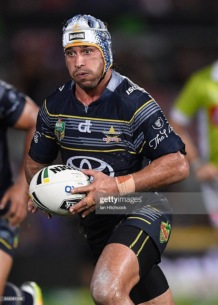 <a gi-track='captionPersonalityLinkClicked' href=/galleries/search?phrase=Johnathan+Thurston&family=editorial&specificpeople=233427 ng-click='$event.stopPropagation()'>Johnathan Thurston</a> of the Cowboys runs the ball during the round 16 NRL match between the North Queensland Cowboys and the Manly Sea Eagles at 1300SMILES Stadium on June 27, 2016 in Townsville, Australia.