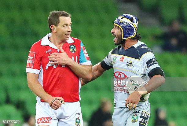 Johnathan Thurston of the Cowboys speaks with referee Ben Cummins during the NRL Qualifying Final match between the Melbourne Storm and the North...