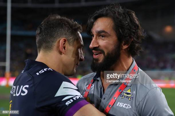 Johnathan Thurston of the Cowboys talks to Billy Slater of the Storm after the 2017 NRL Grand Final match between the Melbourne Storm and the North...