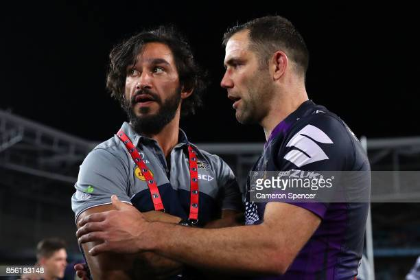 Johnathan Thurston of the Cowboys talks to Cameron Smith of the Storm after the 2017 NRL Grand Final match between the Melbourne Storm and the North...