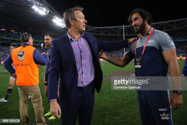 Johnathan Thurston of the Cowboys talks to Storm coach Craig Bellamy after the 2017 NRL Grand Final match between the Melbourne Storm and the North...