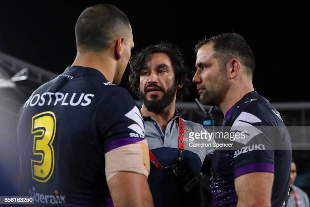 Johnathan Thurston of the Cowboys talks to William Chambers of the Storm and Cameron Smith of the Storm after the 2017 NRL Grand Final match between...