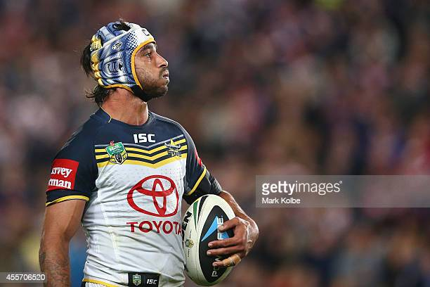 Johnathan Thurston of the Cowboys watches the big screen as he waits as the video referee reviews a try during the 1st NRL Semi Final match between...